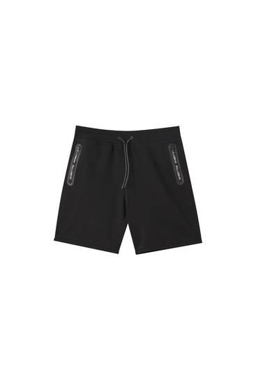 Basic jogging Bermuda shorts with zip pockets