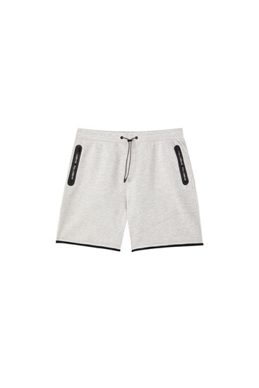 Basic jogging Bermuda shorts with zip pockets