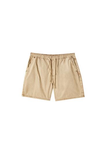 Faded Bermuda shorts with elastic waistband