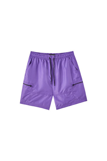 Purple Bermuda shorts with zip pockets