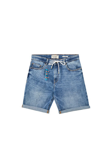Medium blue denim Bermuda shorts with skateboard charm