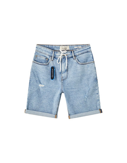 Denim Bermuda shorts with rips and drawstrings