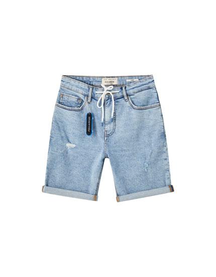 Bermuda di jeans laccio strappi