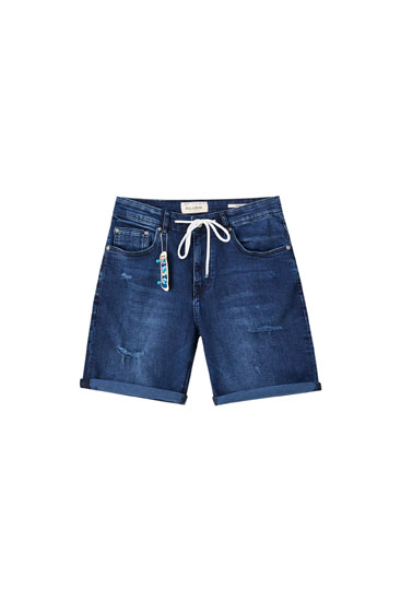 Skinny denim Bermuda shorts with contrast drawstring detail