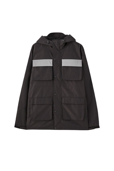 Utility jacket with reflective pockets
