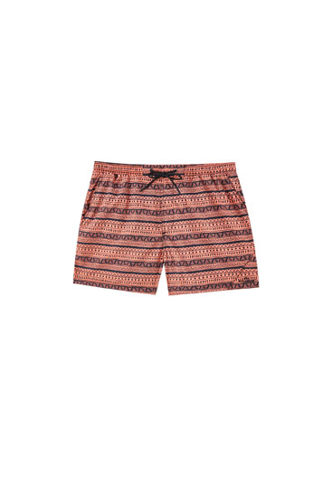 Pink geometric print swimming trunks