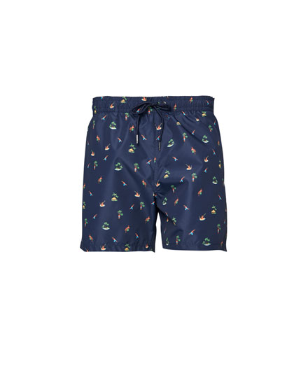 Blue palm tree print swimming trunks