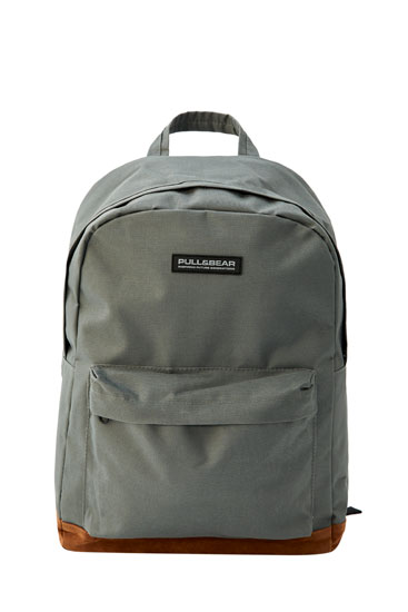 Grey backpack with contrast detail on the bottom