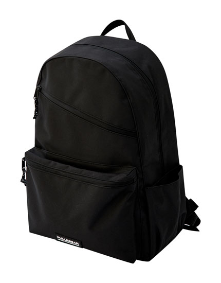Black backpack with diagonal zip