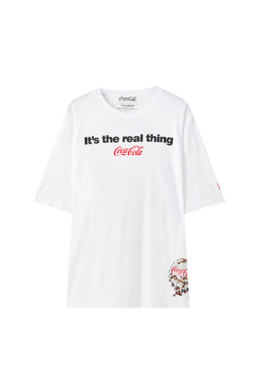 White oversized Coca-Cola slogan T-shirt