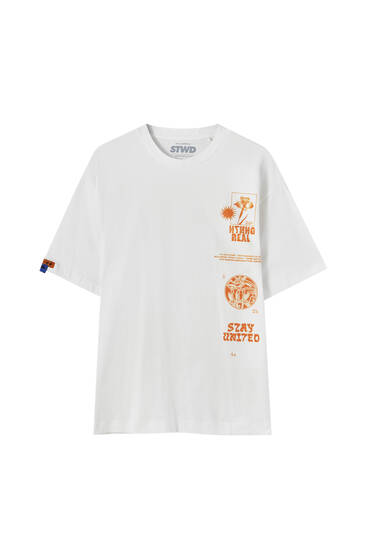 Vit t-shirt med orange tryck