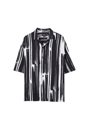 Printed shirt with painted brush strokes