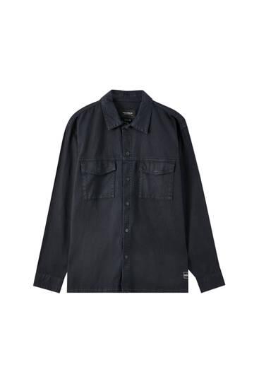 Denim blouse met klepzakken