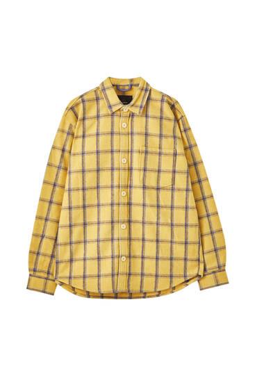 Gele blouse met violet dambordruit