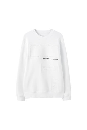 White sweatshirt with raised slogan