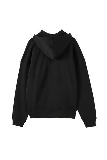 Black hoodie with rubberised illustration