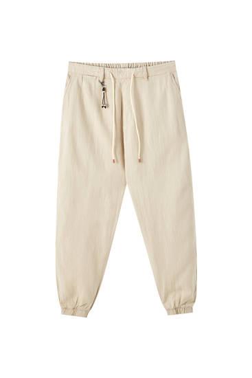 Pantalón chino lino goma bajo