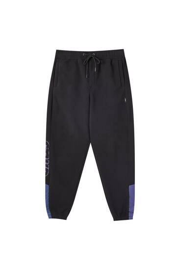 Polartec jogging trousers with iridescent details