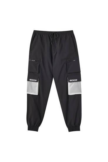 Nylon Sicko19 Sickonineteen cargo trousers with PVC pockets