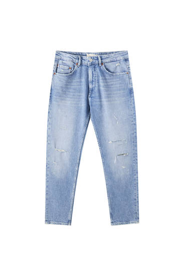 Ripped slim fit tapered jeans