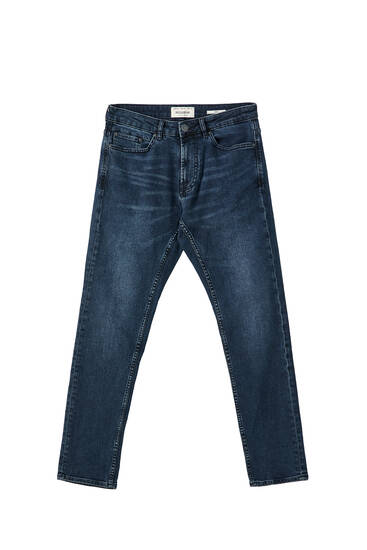 Slim comfort fit jeans with distressed detail
