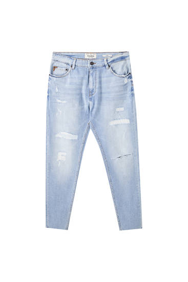 Carrot fit jeans with wide rips
