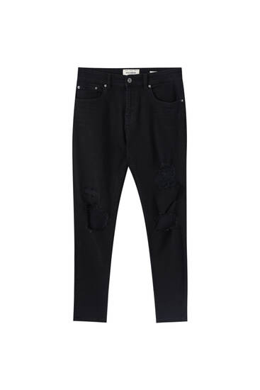Ripped tapered skinny jeans