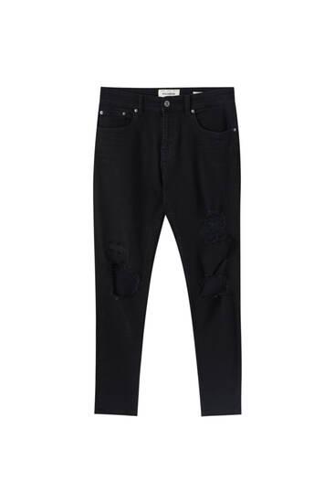 Distressed detaylı tapered skinny fit jean