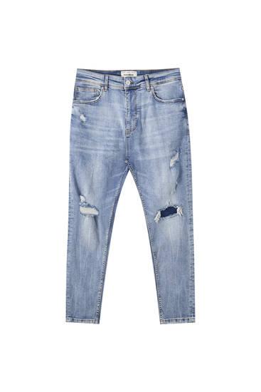 Jeans skinny carrot rotos