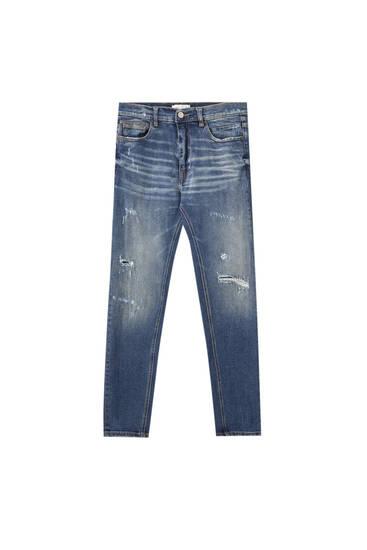 Джинси-керрет класу преміум з подертостями на штанинах