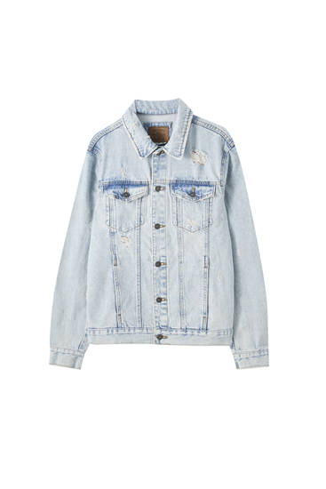 Blue ripped denim jacket