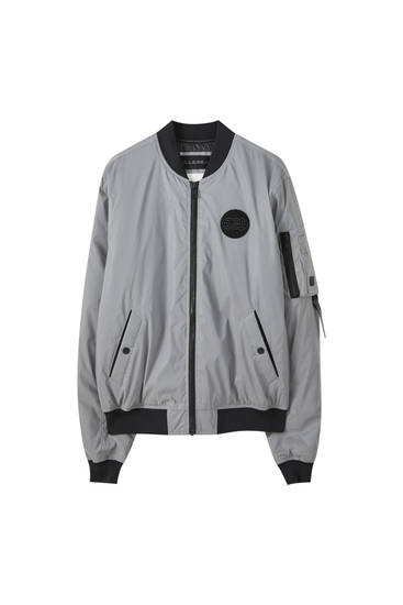 Reflective silver bomber jacket