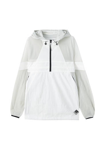 Anorak jacket with transparent panelling