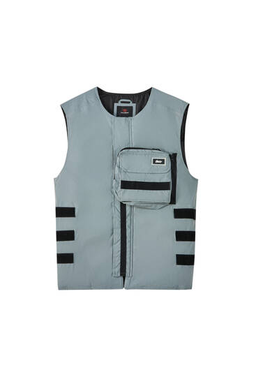 Technical vest with belt bag
