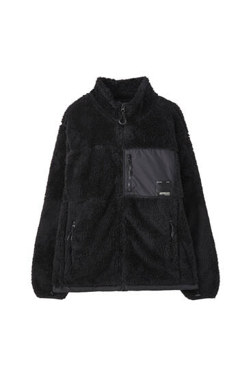 Faux shearling jacket with contrasting fabrics