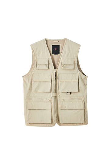 Sand-coloured utility gilet with multiple pockets