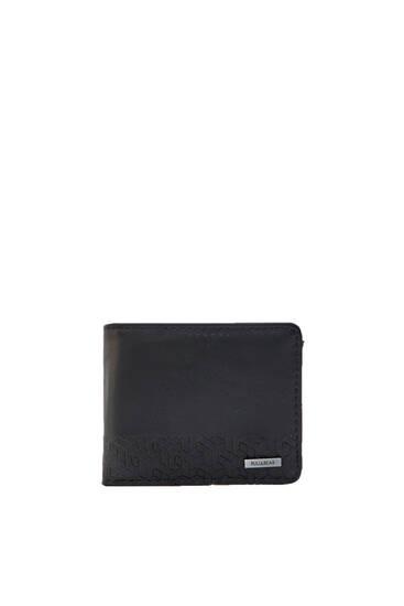 Schwarze Brieftasche mit geometrischem Motiv
