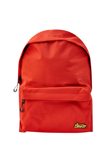 Orange backpack with logo and pocket