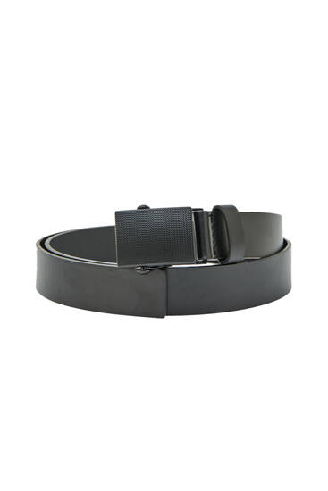 Black belt with plate buckle