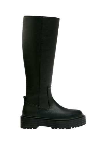 Knee-high boots with track sole