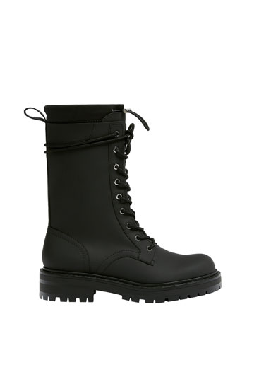 Rubberised lace-up boots