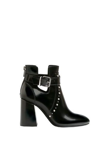 Cut-out ankle boots with faux pearls