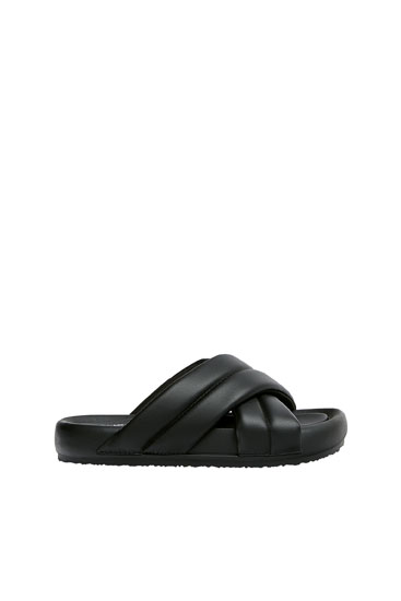 Padded flat crossover sandals