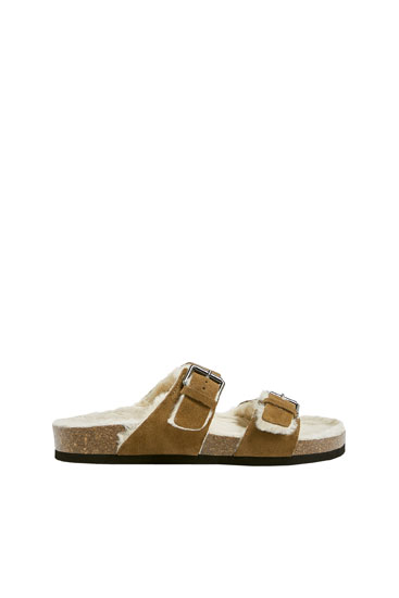 Faux fur flat sandals with buckles