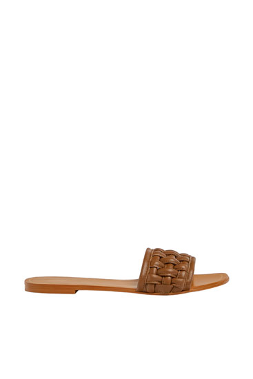 Flat woven leather sandals