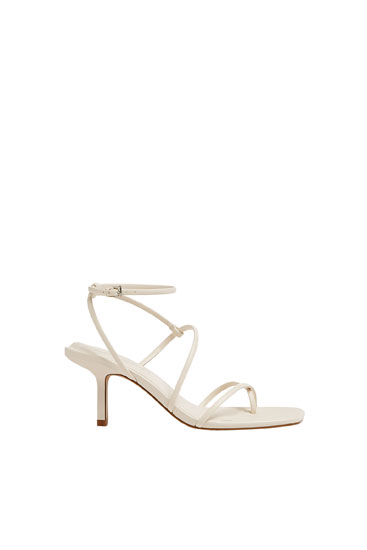 Strappy high heel sandals with a square toe
