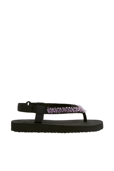 Flat sporty sandals with beaded details