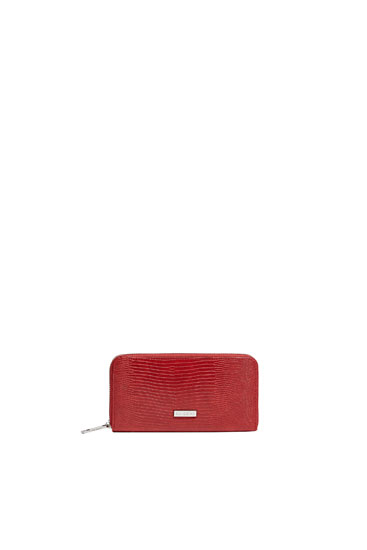 Red purse with embossed detailing