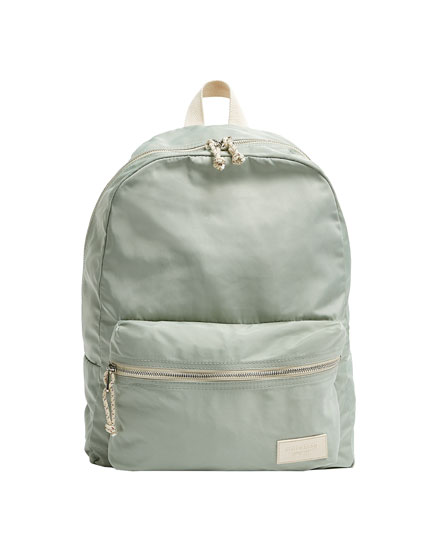 Green nylon backpack