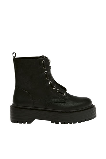 Black platform boots with zip detail